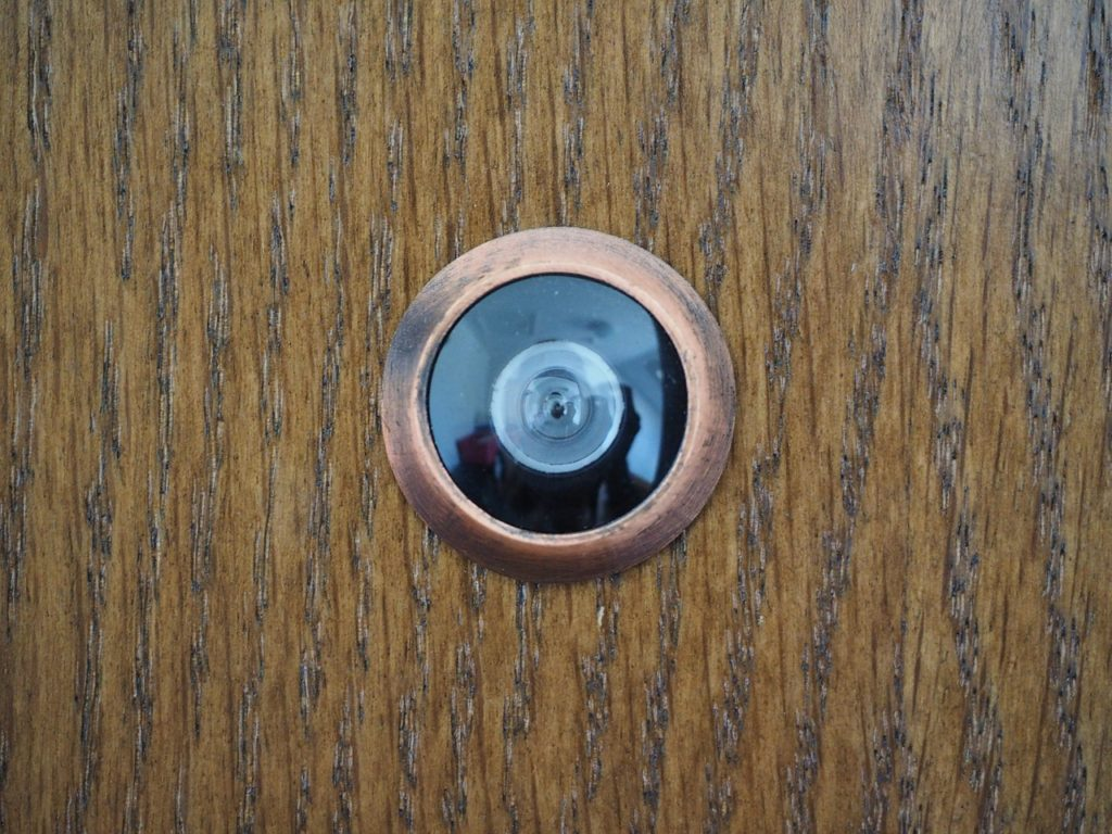 door with a mini spy camera
